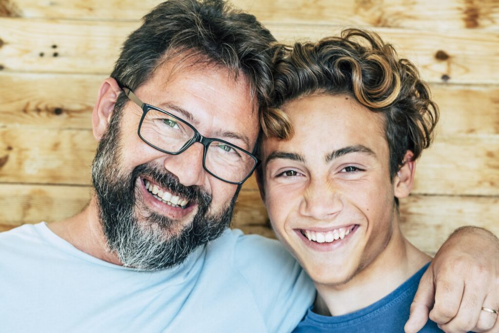 Cheerful people portrait with father and son